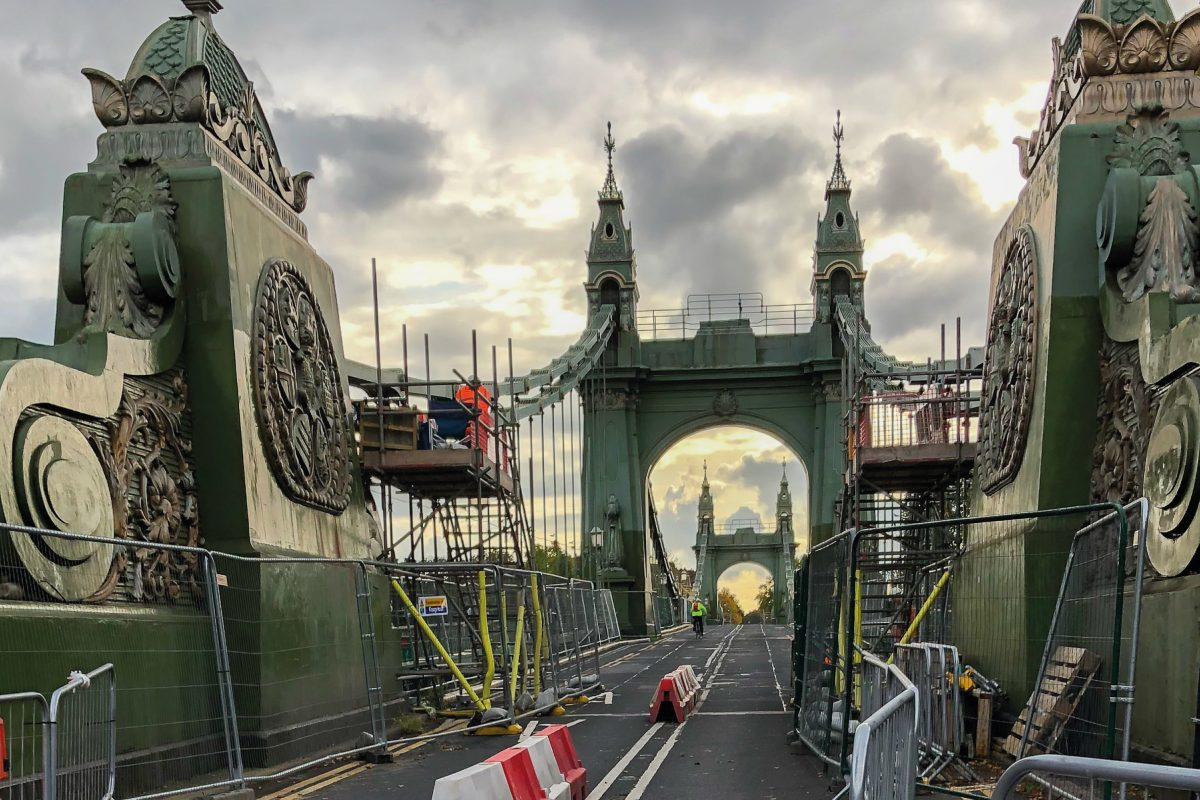 Hammersmith Bridge closed for maintenance works on a cloudy day.